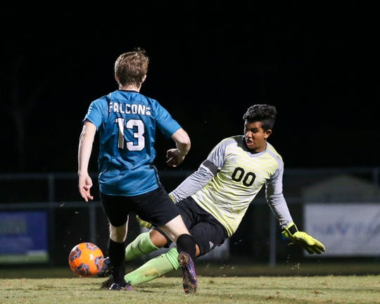 Lincoln Park Academy goalkeeper Vivek Talati (right) gets to the ball ahead of Jensen Beach's Sean O'Brien during the second half of a soccer game at Jensen Beach High School on Wednesday, Jan. 15, 2020, in Jensen Beach.
