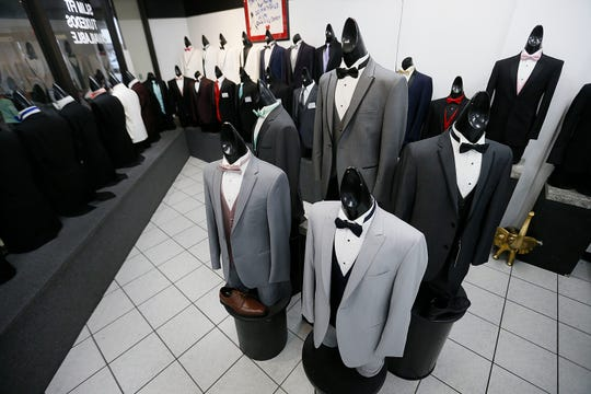 Shades of gray are definitely in formal wear for grooms in 2020, El Paso bridal fashion experts said.