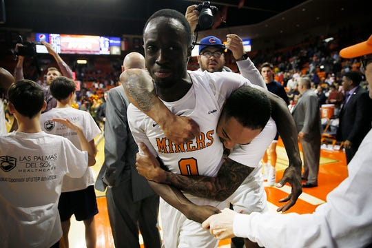 UTEP's Souley Boum and Daryl Edwards celebrate after their 80-77 win in overtime against UTSA Wednesday, Jan. 15, at the Don Haskins Center in El Paso.