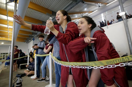 Ysleta swimmers Valerie Salas, right, and Nydia de Avila cheer on teammate Briana Espino in the 500 yard freestyle Thursday during the District 2-5A Swimming Championships at the Westside Natatorium.