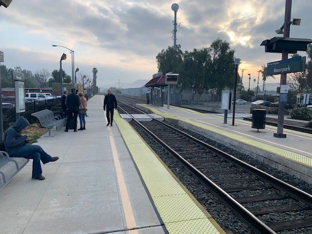 Passengers wait for the train at the Moorpark Metrolink station. Metrolink will begin a trial program in April offering Saturday service from Moorpark and Simi Valley to Union Station in downtown Los Angeles.