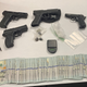 Firearms, narcotics and cash seized during a search warrant in Oxnard on Wednesday.