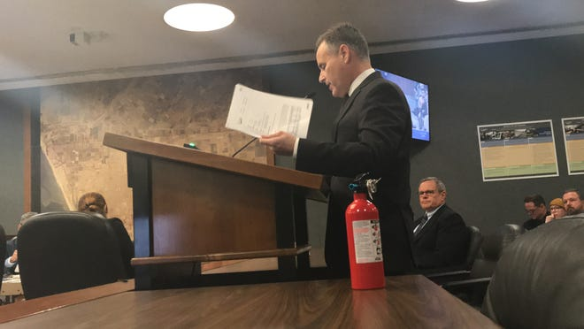 Aaron Starr brought a fire extinguisher to the public comment period of Tuesday's City Council meeting in Oxnard. He disagreed with a report on his initiatives and said everyone's pants were on fire.