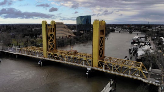 In this Feb. 14, 2019, file photo the Sacramento River flows under the Tower Bridge in Sacramento. Gov. Gavin Newsom's administration officially restarted a project on Jan. 15, 2020, that would divert water from the San Joaquin Delta and send it to Southern California.