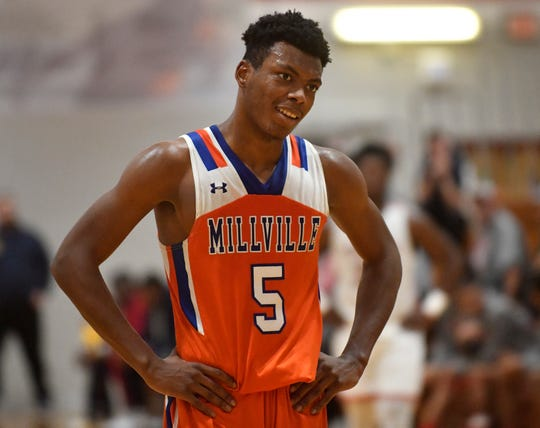 Millville's Randy Butler smiles after a free throw during Wednesday's basketball game against Vineland. The visiting Thunderbolts topped the Fighting Clan 55-51 in overtime on Jan. 15, 2020.