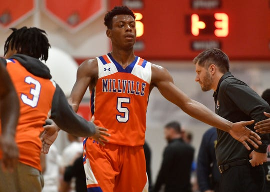 Millville's Randy Butler celebrates with teammates during Wednesday's basketball game against Vineland. The visiting Thunderbolts topped the Fighting Clan 55-51 in overtime on Jan. 15, 2020.