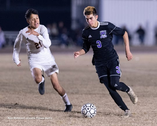 Mission Oak's Isaiah Borjon, right, against Tulare Union in a boys high school soccer match on Tuesday, January 14, 2020.