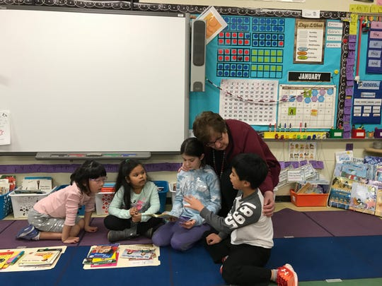 Link Elementary School Principal Francine Cuccia talks with students in 2nd grade teacher Courtney Tully's classroom on Monday, Jan. 13, 2020. Students were sharing lessons with kindergartners. Cuccia retires at the end of the 2019-2020 academic year.