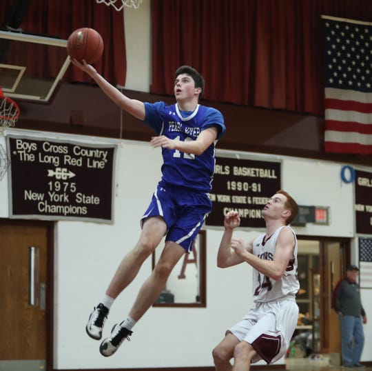 Pearl River's Jack Michaelson (12) puts yop a shot during their 51-42 win over Albertus in boys varsity basketball action at Albertus Magnus High School in Bardonia on Wednesday, January 15, 2020.