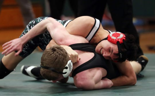 Pleasantville's Brian Straus on his way to defeating Putnam Valley's Finbar Cronin in the 145-pound weight class during wrestling action at Pleasantville High School Jan. 15, 2020.