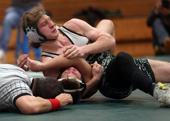 Pleasantville's Zach Mallozzi on his way to defeating Putnam Valley's Travis Appell in the 138-pound weight class during wrestling action at Pleasantville High School Jan. 15, 2020.
