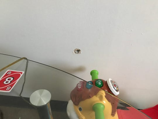 A bullet exit hole in the toy room belonging to Brandon Roberts' son, attorneys said.