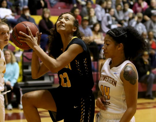 Cameron's Jazmin Luster looks to the basket by Midwestern State's Kityana Diaz Wednesday, Jan. 15, 2020, at D.L. Ligon Coliseum.