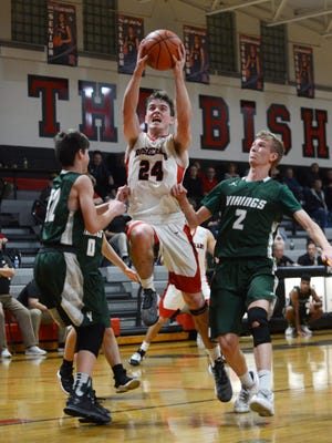 Rosecrans senior Weston Nern splits a pair of Northridge defenders during a regular season win at Rogge Gymnasium. Nern was named second-team All-Ohio on Monday by the Ohio Prep Sportswriters Association.