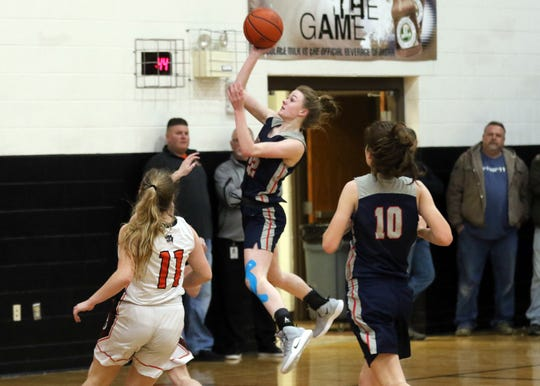 Morgan's Sophia Smith  puts up a shot against New Lexington Wednesday night.
