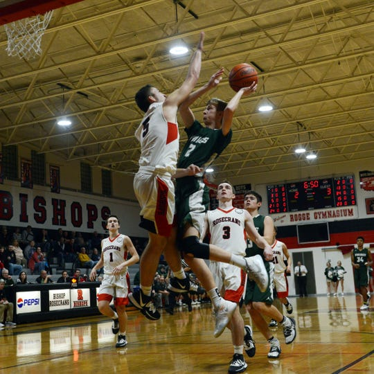 Northridge's Ben Smith goes up for a shot against Rosecrans' Marcus Browning during the first quarter on Wednesday night at Rogge Gymnasium. The Bishops won, 68-54, to remain unbeaten.
