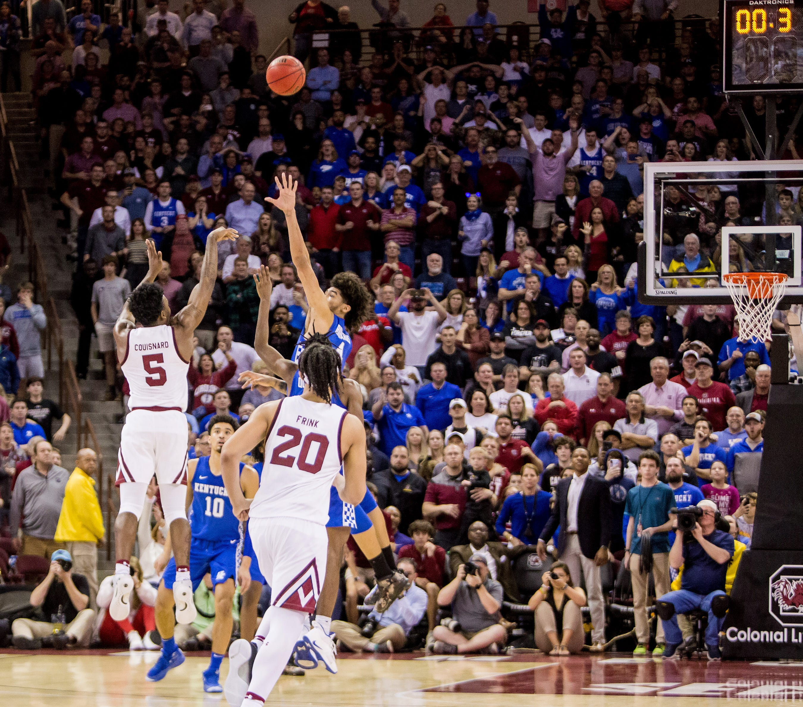 South Carolina upsets No. 12 Kentucky with banked-in 3-pointer at buzzer