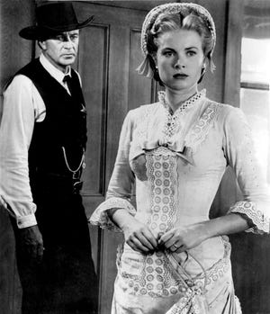 "Marshal Will Kane (Gary Cooper) and his wife Amy (Grace Kelly) face deadly desperadoes in ""High Noon."""