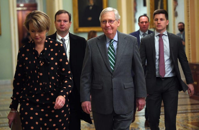Senate Majority Leader Mitch McConnell, R-Ky., arrives at the Capitol in Washington on Jan. 16, 2020.