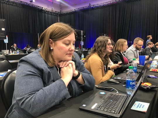 Annah Aschbrenner, 2020 editor for the USA TODAY Network, works at the CNN/Des Moines Register debate on Jan. 14, 2020, at Drake University in Des Moines, Iowa.