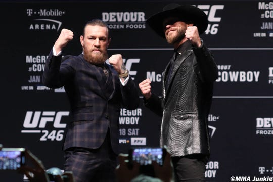 """Conor McGregor, left, and Donald """"Cowboy"""" Cerrone pose during a press conference for UFC 246."""