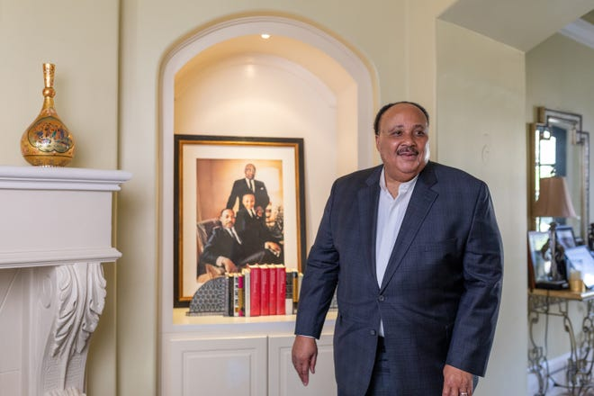 Martin Luther King III stands in front of a portrait of him and his father, Martin Luther King Jr., in his Atlanta home on Jan. 9, 2020. As the holiday celebrating Martin Luther King Jr. approaches on Jan. 20, his son talked about the importance of keeping his legacy alive. At a time when the country still struggles with racism and white supremacy, King III continues to build on his father's dream and the fight for equality.
