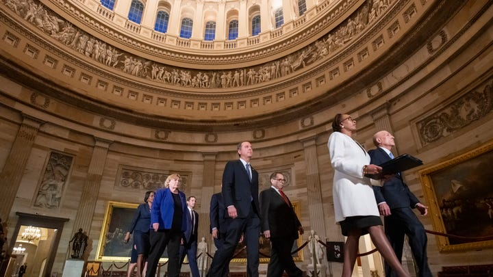 House Impeachment Managers, led by the House Clerk and the House Sergeant at Arms walk through the Capitol Rotunda to present the articles to the Senate on jan. 15, 2020. The following morning, on Jan. 16, Rep. Adam Schiff read the articles of impeachment on the Senate floor.
