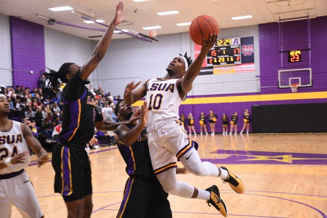 LSUA's Montrey Thomas (10) goes up for two against LSUS Thursday.