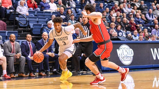 Monmouth's Deion Hammond drives against a Marist defender in the Hawks' victory on Thursday night at OceanFrist Bank Center in West Long Branch.