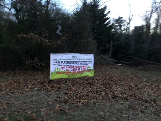 This picture shows a sign that opponents to the Monmouth Commerce Center erected near the proposed construction site. They say it was vandalized in early January, after this picture was taken.