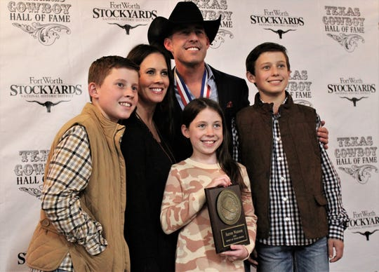 Texas Cowboy Hall of Fame inductee Aaron Watson, center, poses for a family photo Thursday at Billy Bob's Texas. Attending the ceremony were, from left, son Jack, wife Kimberly, daughter Julia Grace and son Jake. Also at the event were Watson's parents, Ken and Andra.