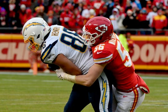 Los Angeles Chargers tight end Hunter Henry (86) is tackled by Kansas City Chiefs linebacker Ben Niemann (56) during the second half in Kansas City, Mo., Sunday, Dec. 29, 2019.
