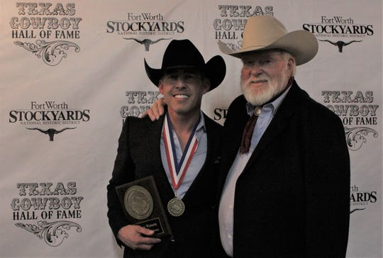 Texas singers and good friends Aaron Watson, left, and Red Steagall pose for a photo after Watson was inducted into the Texas Cowboy Hall of Fame with the Spirit of Texas Award. Steagall is a past inductee.