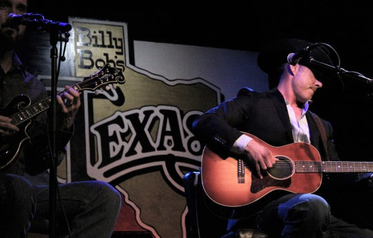 Aaron Watson played a few of his songs that he said related best to Texas and the cowboy life at the Texas Cowboy Hall of Fame induction at Billy Bob's Texas in Fort Worth on Thursday. Watson was one of five honorees.