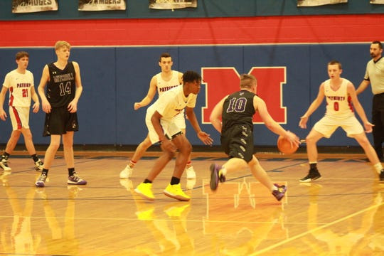 Madison beat Mitchell 73-66 to extend their win streak to seven.