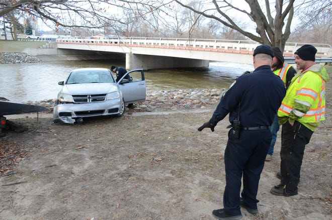Crews removed this car from the Battle Creek River Friday.