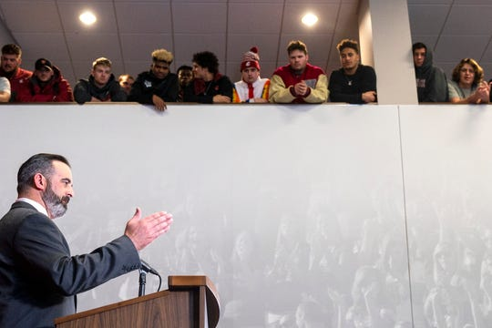 New Washington State football coach Nick Rolovich speaks during a press conference as players from the team look on from a balcony Thursday, Jan. 16, 2020, in Pullman.