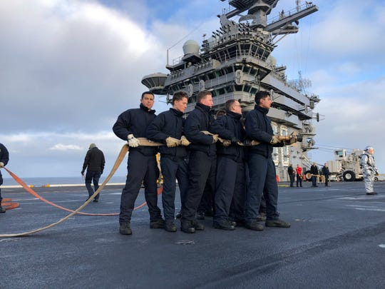 Every sailor is also a firefighter. Last week, Nimitz sailors trained for a fire on the flight deck, moving together in unison. A new generation of sailors, many of whom are on the Nimitz in their first experiences at sea, is being trained.