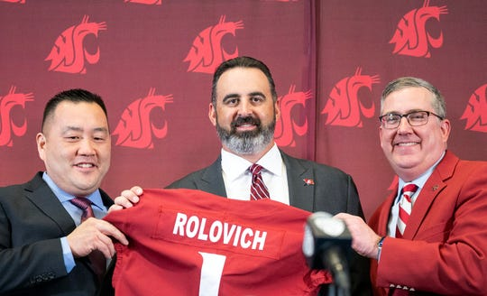New Washington State football coach Nick Rolovich, center, is introduced by Washington State Athletic Director Pat Chun, left, and Washington State President Kirk Schulz during a press conference on Thursday, Jan. 16, 2020, in Pullman.