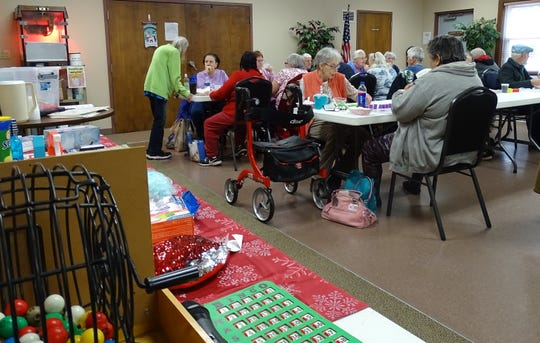 Senior citizens share a meal before playing bingo on Thursday at the Crawford County Council on Aging.