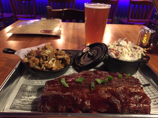 Baby-back ribs, roasted cauliflower and coleslaw at Smokey's Pit Stop inside Orlando's Bar in Burlington.