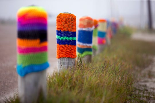 Diana Vondra originally used scrap yarn for her Bollard Buddies, but as the project grew, she began buying yarn for the project. Now she uses acrylic yarn because it has a more vivid color.