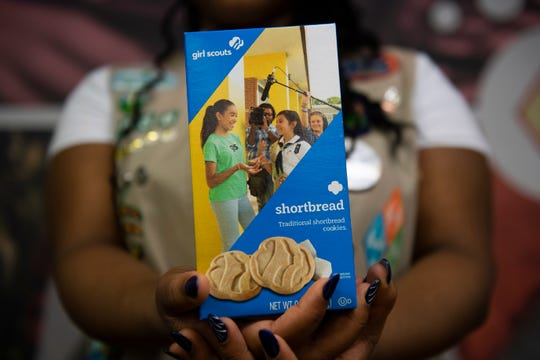"Girl Scout Bryana Turner, 14, of Lindenwold poses with her box following a ""cookie reveal"" event at Girl Scouts of Central & Southern NJ in Cherry Hill, Thursday, Jan. 16, 2020. Turner is an aspiring videographer."