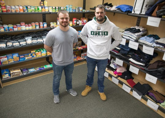 Veterans Cody Anderson, left, and Matt Bush help run the Hilltopper Resource Center, a college food pantry, at OUC. The center, which opened in December, provides a place for Bobcats in need to go to get access to food, clothing, and other basic necessities.