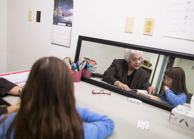 (L-R) Retired reading teacher and dyslexia specialist Beverly Gray helps Alana Stockmeister with her reading and oral listening skills at the David Ater ADHD and Dyslexia Clinic in Chillicothe, Ohio, on Jan. 16, 2020.