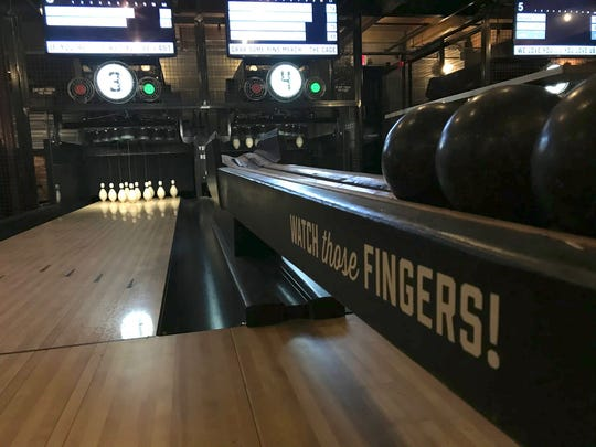 Pins Mechanical Company has duckpin bowling on two floors.