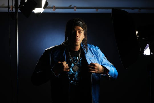 Nicholas 'Sunny' Race, of Covington, photographed in the Enquirer's photo studio on January 16. Race is a sound engineer who often works with DJ Corbett, a music producer, from Florence, who is nominated for a Grammy in the 'Best Rap Song' category.