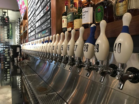 40 craft beers are on tap alongside a hefty wine menu at Hoppin' Vines.