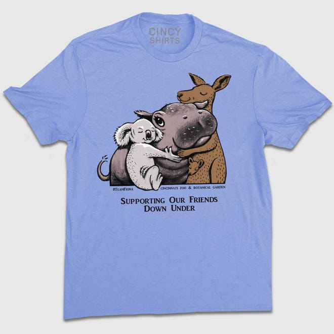 T-shirts featuring Fiona the hippo hugging a kangaroo and a koala have raised nearly $100,000 for animals suffering in the Australian bush fires.