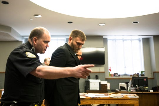 Dallas Frazier is directed by a court officer after Judge Brad Greenberg sentenced him to 120 days in county jail for assault on Friday, Jan. 17, 2020, at the Hamilton County Courthouse in Cincinnati. Frazier was convicted of misdemeanor assault from an Aug. 1, 2019, incident outside a President Donald Trump rally at U.S. Bank Arena.